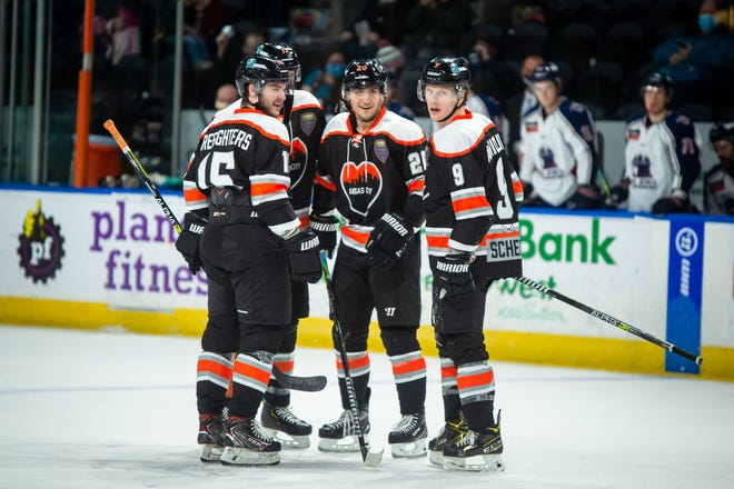Kansas City Mavericks forward Nick Pastujov, center, is congratulated by teammates after scoring an insurance goal in the third period of a 3-1 win over the Tulsa Oilers Saturday at Cable Dahmer Arena.