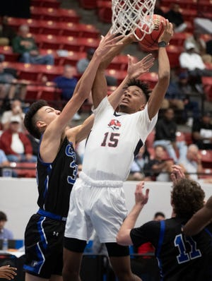Jackson forward James Morrow (15) grabs a rebound over Community School of Naples forward Ryker Vance (35) during the 2020 Class 3A FHSAA boys basketball semifinal. Jackson plays in its third consecutive final four on Wednesday.