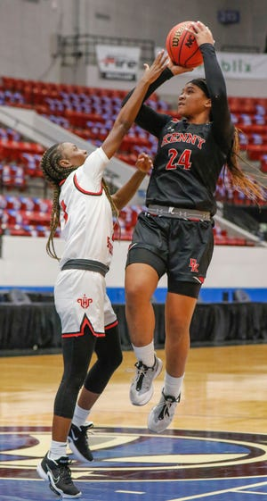 Bishop Kenny's Jasmyne Roberts (24) shoots over Lake Highland Prep guard Eleecia Carter in the FHSAA girls basketball state semifinal in Lakeland on Feb. 25. The Bishop Kenny senior finished second in Miss Basketball voting.