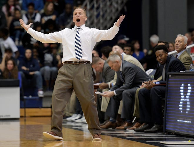 UNF head basketball coach Matthew Driscoll, shown here reacting to a foul call in the 2020 A-Sun tournament win over Jacksonville University, and the Ospreys have a lot of lineup uncertainty facing them in Thursday's quarterfinal matchup against North Alabama at JU's Swisher Gym.