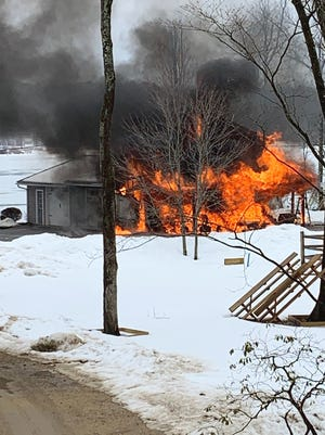 A garage burns on Laurelwood Drive in Westminster on March 1.