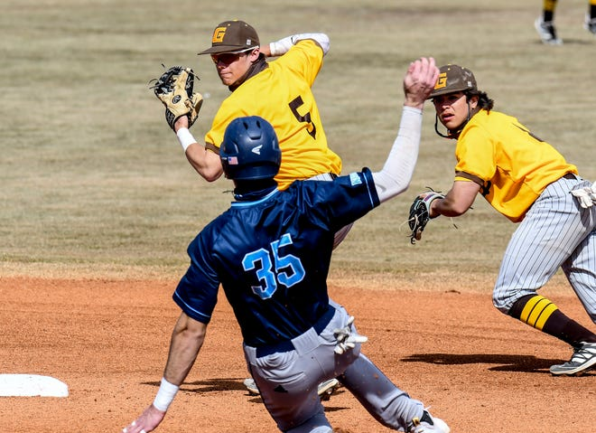 Garden City Community College shortstop Kyle Jameson readies to throw to first base to complete a double play after tagging second base to get Colby's Jake Ticer out Saturday at Williams Stadium.  Shown at right is GCCC second baseman Ryan Muniz.