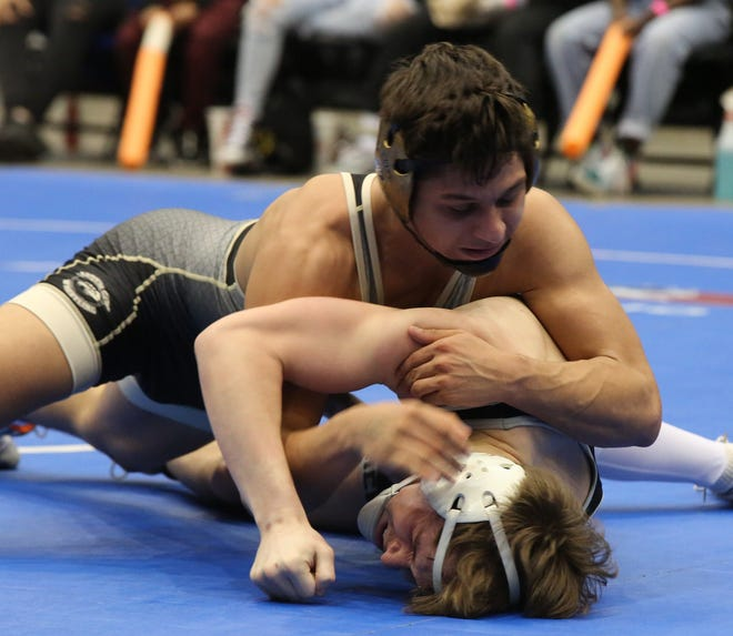 Garden City's Erick Dominguez works on top of Lawrence Free State's Caleb Streeter on his way to a win in their 138-pound semifinal Saturday at the Class 6A State Championships at Hartman Arena.