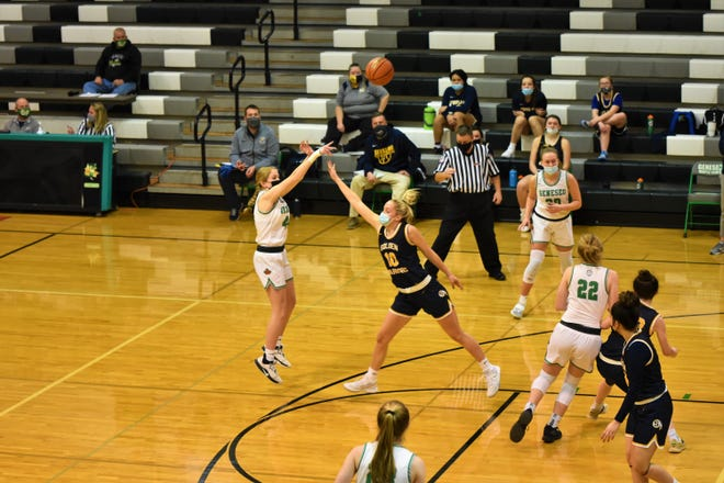 Danielle Beach, Kammie Ludwig, and Maddi Barickman in action in the Lady Leafs victory over Sterling in the GHS gym.
