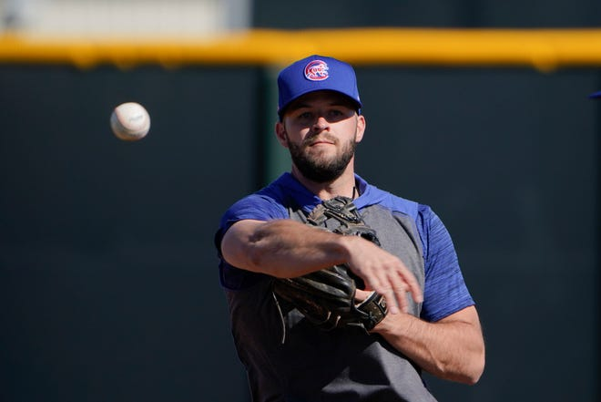 The Chicago Cubs' David Bote throws the ball during the team's spring training workout in Mesa, Ariz. on Monday, Feb. 22.