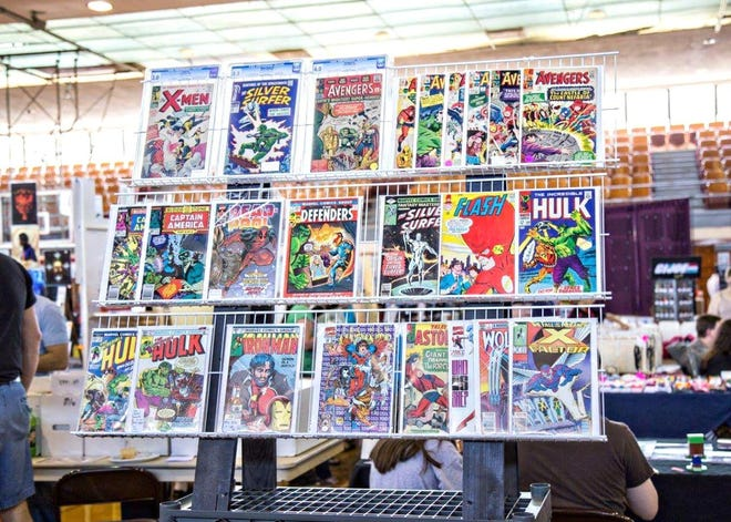 Comic books are displayed at the Tulip City Comic & Toy Fare event in Holland Civic Center during its debut in May 2016. The event has been canceled for 2021 due to safety concerns surrounding the ongoing pandemic.