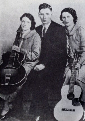 """One of Granny and Grandpa's favorite singing groups was the Original Carter Family. Many of their recordings were among Grandpa's collection of 78 rpm records, including """"Wildwood Flower."""" A.P. Carter (1891-1960), Sarah Carter (1898-1979), and Maybelle Carter (1909-78) were pioneers in country music. The Victor Talking Machine Company introduced their unique talents to a nationwide audience in 1927."""