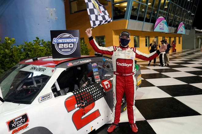 Myatt Snider celebrates after winning the NASCAR Xfinity Series auto race Saturday, Feb. 27, 2021, at Homestead-Miami Speedway in Homestead, Fla.