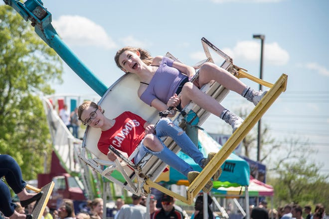 Attendees of the 2019 Dogwood festival enjoy the many festival rides outside of Camdenton R-III middle school.