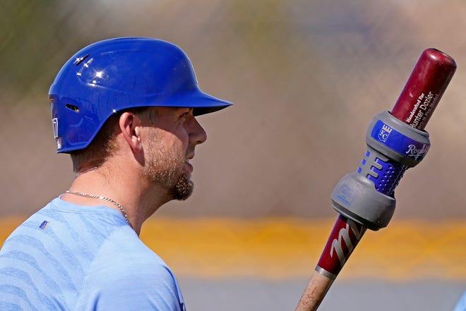 Kansas City Royals' Hunter Dozier gets ready to bat during spring training baseball practice Monday, Feb. 22, 2021, in Surprise, Ariz.