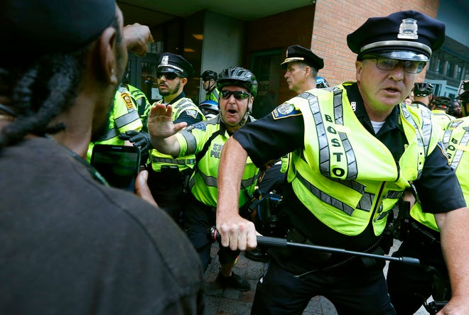 """Counterprotesters clash with police following a """"Free Speech"""" rally staged by conservative activists in Boston in August 2017. The Boston Police Department remains largely white in 2021, despite vows for years by city leaders to work toward making the police force look more like the community it serves."""