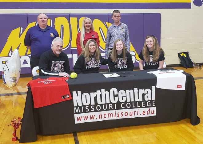 Madison High School senior Mallory Greiwe signed a letter of intent on Feb. 22 announcing her intentions to play college softball while continuing her education at North Central Missouri College in Trenton for the 2020-21 academic year. Mallory (seated second right) is shown with her parents David and Amy Greiwe and her sister Payton (right). Standing are Madison softball head coach Jon Link, NCMC assistant softball coach Sara Van Duke, and Madison assistant coach Philip O'Neal.