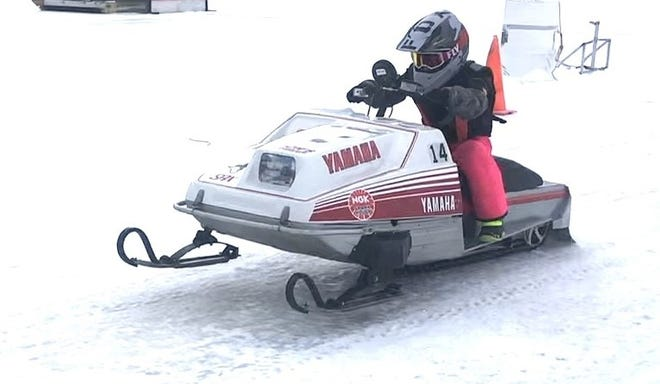 Molly Hoffman, a fourth-grader from Ida, recently won adult snowmobile races at Houghton Lake.