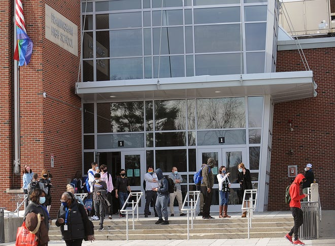 Students are shown leaving Framingham High School last Wednesday. Enrollment in the Framingham School District is down by 346 students this year, according to state numbers.