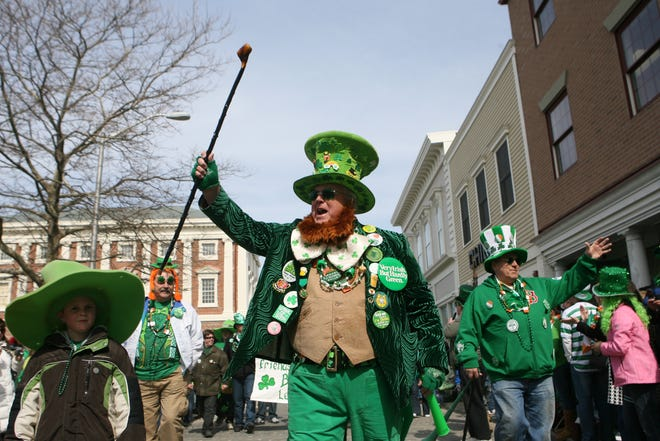 """Coventry's Steven O'Brien, """"the world's biggest elf,"""" leads his clan in the 2009 edition of the Newport St. Patrick's Day Parade."""
