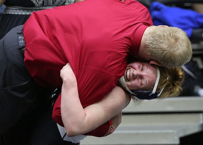 Ottawa's Darby Weidl won her 155 weight class KSHSAA Girls Div II State Wrestling Championship then celebrated by tackling her coach, her brother, Dalton Weidl who won his state wrestling championship in the 195 weight class seven years ago in Salina.