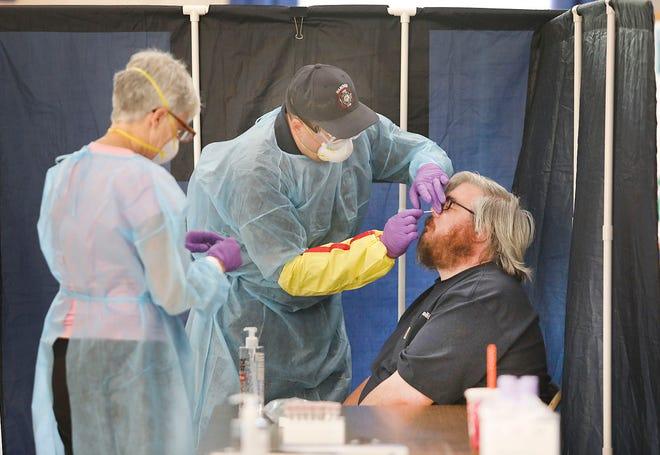 Hanover school custodian Jason Hook is tested for COVID 19 at Hanover Middle School on Monday, Sept. 14, 2020.  Greg Derr/ The Patriot Ledger