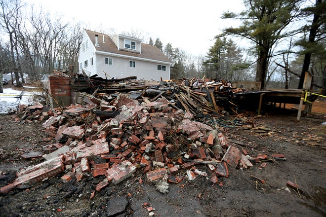 The destroyed home at 7 Holland Drive in Rye is seen Monday, March 1, 2021, a day after the blaze.
