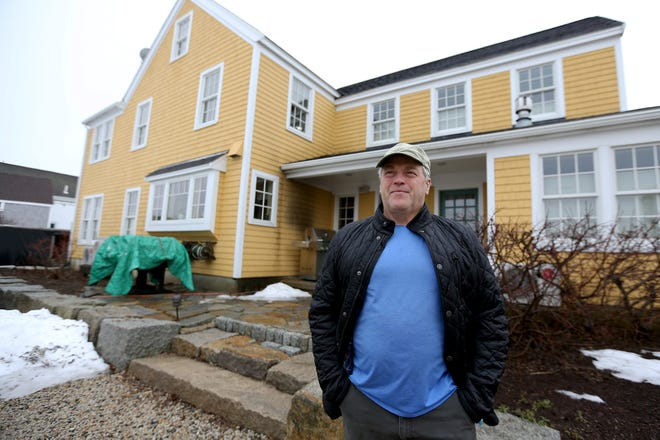 South End resident Glenn Normandeau stands in front of his house at 15 Pickering Ave. on Monday morning. A flood insurance owner, Normandeau could see his premium rate increase later this year as FEMA unveils a new risk rating evaluation program for the first time in decades.