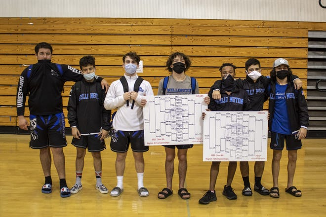 Wellington wrestlers who are headed to the state championships pose for a picture Saturday. Pictured (left to right): Mason Powell, Evan Pena, Seth Rhodes, James Marvel, Patrick Jones, Ethan Howard, and Sam Marvel.