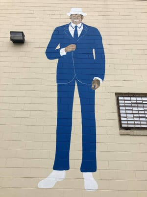 Mural on the Fashion Care Cleaners building located at 18 South Adams Street in Petersburg, Va.