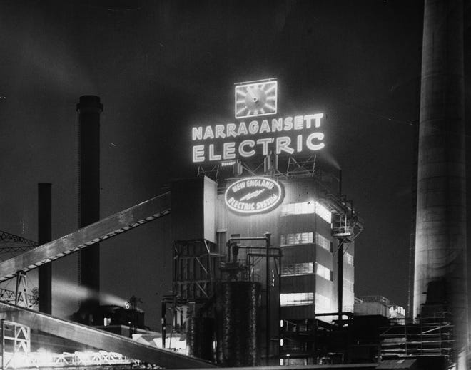 The Narragansett Electric Co. sign became a new Providence landmark when it was switched on March 18, 1954. The 11,000-watt sign was 72 feet long and 59 feet high from the roof to the top of the clock.