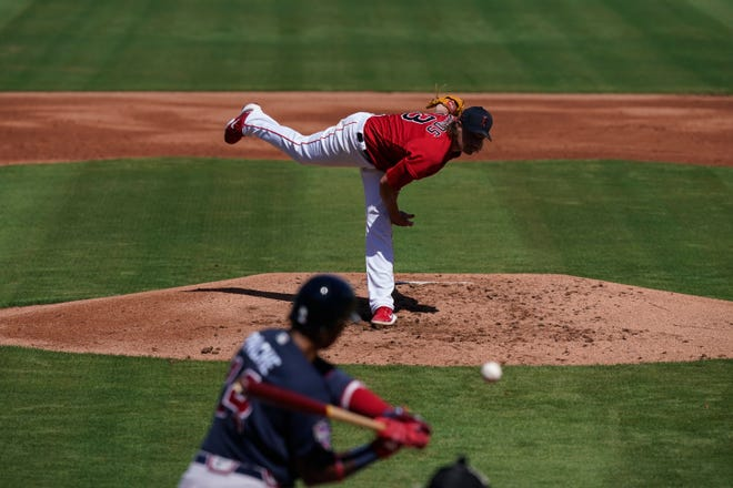 Red Sox starting pitcher Garrett Richards delivers against the Atlanta Braves on Monday, in Fort Myers, Fla. After a rough first inning, he settled down for a 1-2-3 second.