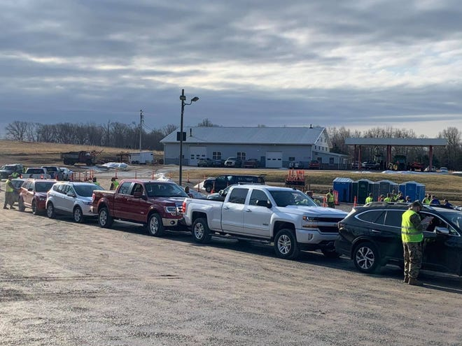 Cars line up at a mass vaccination event at the Knights of Columbus Hall in Leopold, Mo., on Feb. 24.