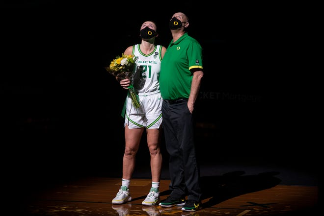 Erin Boley and Coach Kelly Graves hug and watch the recap of Boley's basketball career with the University of Oregon. No. 14 Oregon Ducks wrap up the regular season with a rivalry showdown against Oregon State in Matthew Knight Arena on Sunday, Feb. 28, 2020.