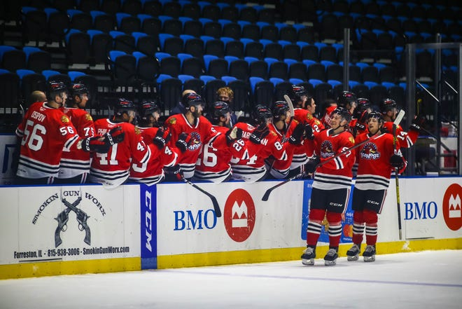The Rockford IceHogs, shown celebrating a goal, had their game in Cleveland postponed on Sunday due to the Monsters' COVID-19 protocol.
