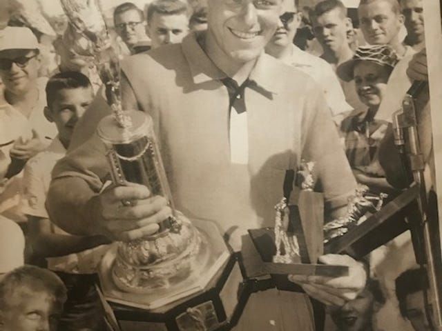 Ken Scott holds his trophies for winning the Rockford Men's City title, along with medalist honors during qualifying, in 1955. Scott was picked as the No. 6 greatest golfer in Rockford-area history.