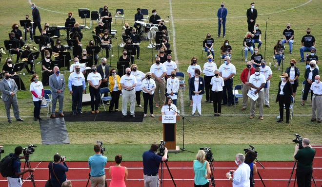 Manatee County School District administrators are joined by the Braden River High jazz band, chorus and members of the media on the school's football field for the Champions of Education kickoff event. Faith Bench, the 2020 Educator of the Year and curriculum specialist, spoke about all that the district has been through in the last year.