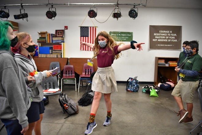 """Students in Michael Bajjaly's sixth-grade theater class are each writing and directing a two-person play.  Edgar Cuiyuch, right, has written a play titled, """"One Step of a Dance"""" set in France.  Here, he directs classmate Kaylee Kline, center, as Autumn Bonner, far left, and Ayden Helmer, second from left, look on. Manatee School for the Arts"""
