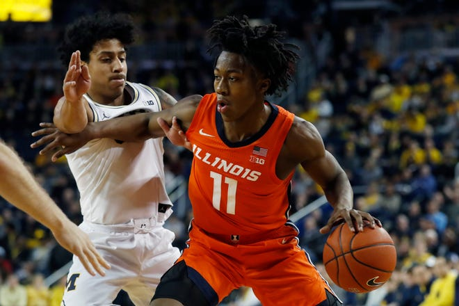 Illinois guard Ayo Dosunmu is defended by Michigan guard Eli Brooks during the first half last season on Jan. 25, 2020, in Ann Arbor, Mich. (AP Photo/Carlos Osorio, File)