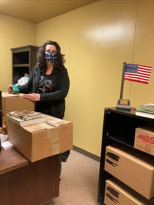 SSC Professor of Social Sciences Marta Osby prepares to temporarily move out of her office in the Milt Phillips Building and relocate across campus until flooding damage has been addressed.