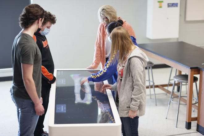 Kewanee High School Students explore anatomy using the district's latest technology acquisition. From left: Kevin VanWassenhove, Walkyr Peed, science teacher Kelly Ellerbrock, Natalie Lopez and Delaney Reynolds. The table was purchased by the Kewanee Schools Foundation through the Frances Horler trust.