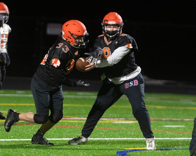 The MIAA's Fall II season is here, with football on tap for March and April. Last week, the Sachems hit the field for the first practices since the 2019 fall season. Here, quarterback Tim Crowley hands of to DJ Campbell during a practice session on the new multi-use field at Middleboro High School.