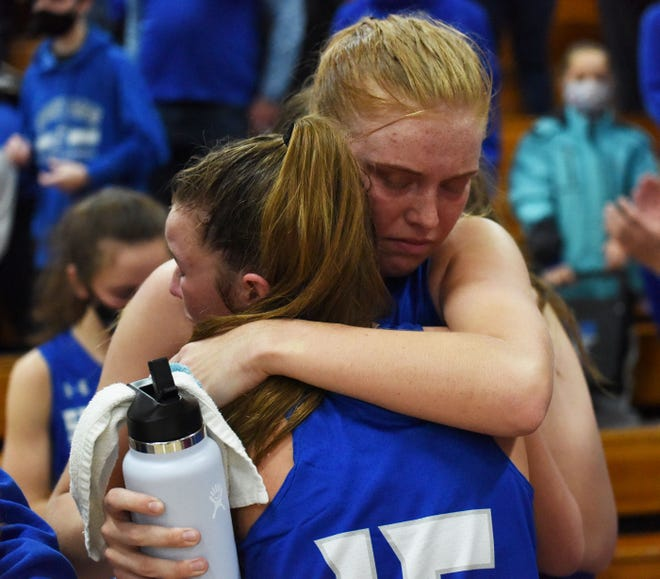 Collins-Maxwell's Reagan Franzen gets a hug from her best friend Brooke Christie (15) after their fantastic 22-2 senior season came to a close with a 62-44 loss to No. 6 Montezuma in the 1A regional finals at Pleasantville Feb. 24.