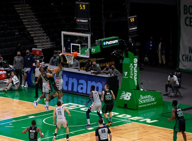 Boston's Jayson Tatum scores the winning basket against Washington during the fourth quarter Sunday's game.