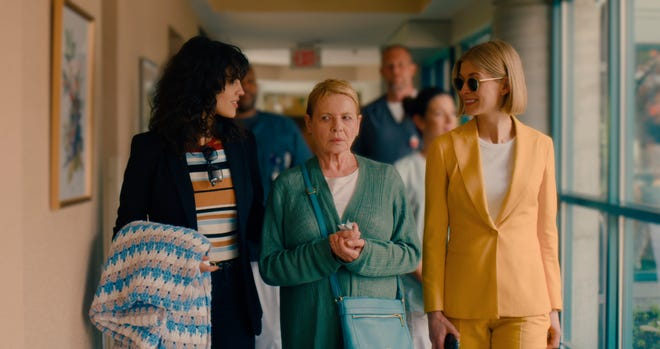 """Eiza Gonzalez, Dianne Wiest and Rosamund Pike are shown in a scene from """"I Care A Lot,"""" a movie streaming on Neflix that tells a story involving the financial exploitation of the elderly."""