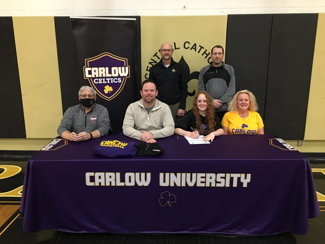 Tuscarawas Central Catholic senior Sage DeBois-Winnie signed a Letter of Intent to play basketball at Carlow University in Pittsburgh Pa. DeBois-Winnie will be majoring in Criminology.  Pictured in the first row left to right are Coach DeSalvo (Carlow University), Brandon Winnie  (father), Sage DeBois-Winnie and Dana DeBois  (mother) Second row left to right is TCC Girls Head Coach Greg Triplett and TCC Girls assistant coach Scott Rimer.