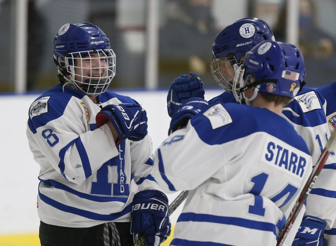 Hilliard's Alex Kerr (8) celebrates his goal against Westerville earlier this season with teammates Luke Starr (14) and Jesse Stevens (10). In the 12-team Buckeye Cup state tournament, the Wildcats lost to Medina 5-2 in a semifinal Feb. 28 at Chiller North.