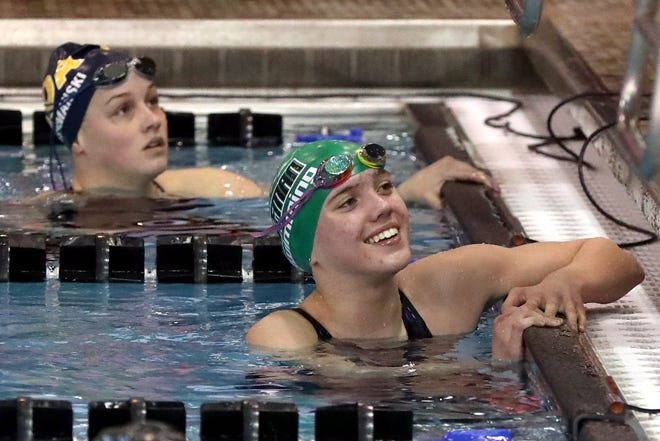Coffman freshman Emily Brown is all smiles after winning the 200-yard freestyle in the Division I state meet Feb. 26 at Branin Natatorium in Canton. She also won the 500 free, giving her half of the Shamrocks' individual titles in the two-day meet.