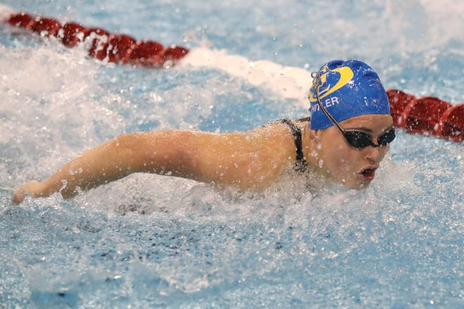 Gahanna Lincoln's Kendall Hitler competes in the 100-yard butterfly during the Division I state meet Feb. 26 at Branin Natatorium in Canton. She finished eighth to reach the awards podium, helping the Lions place 10th as a team.