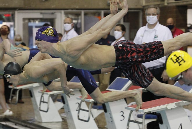 Reynoldsburg senior Nate Gaver takes off for the start of the 50-yard freestyle during the Division I state meet Feb. 27 at Branin Natatorium in Canton. Gaver placed third in the 50 free and seventh in the 100 breaststroke.