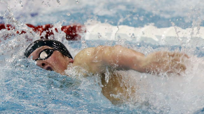 St. Charles junior Spencer Aurnou-Rhees swims on the third-place 400-yard freestyle relay during the Division I state meet Feb. 27 at Branin Natatorium in Canton. He also was second in the 100 free and third in the 200 free.