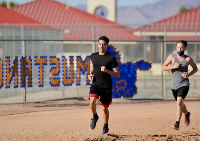 Lucerne Valley High School cross country runners practice ahead of their first Cross Valley League meet on Tuesday, March 2, 2021.