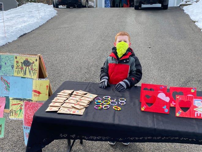 Austin Cooper, 7, selling homemade items to raise money for the Carolina Hll Shelter.