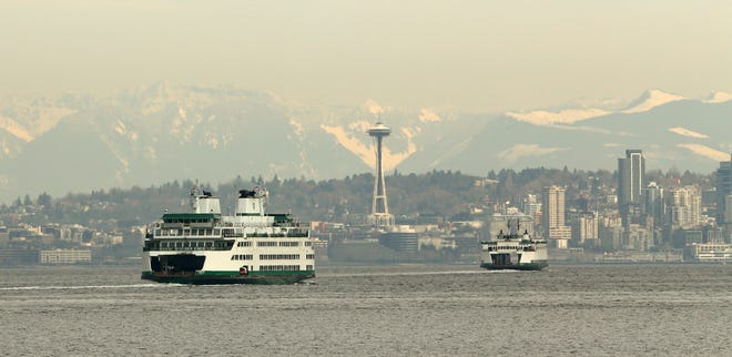 The Washington State Ferries vessel Chimacum follows another ferry toward Seattle on Monday, March 1, 2021.