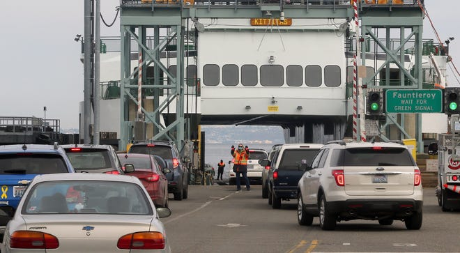 Traffic is loaded onto the Washington State Ferry Kittitas at the Southworth ferry dock on Monday, March 1, 2021.